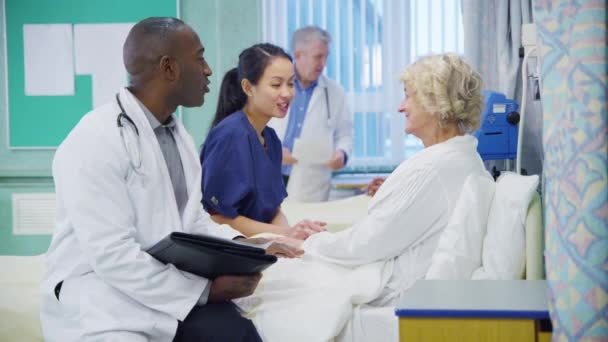 Doctor and nurse chatting with patient