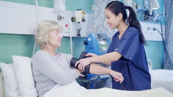 Nurse taking care of patient — Stock Video © Hotelfoxtrot ...