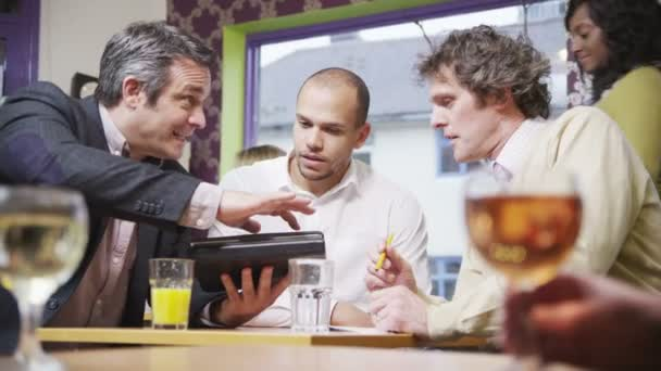 three cheerful businessmen in casual meeting in a cafe