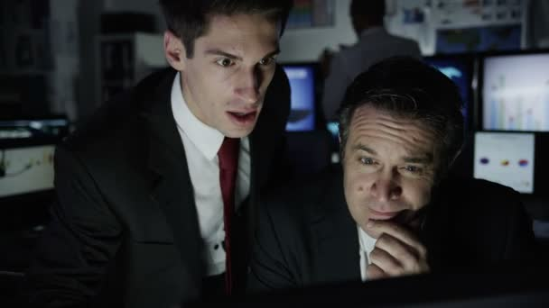 Two businessmen are working late at night