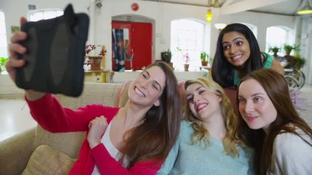 Happy casual young female friends posing for a photograph