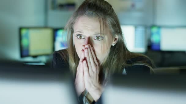 Businesswoman working late is upset by something she sees on her computer