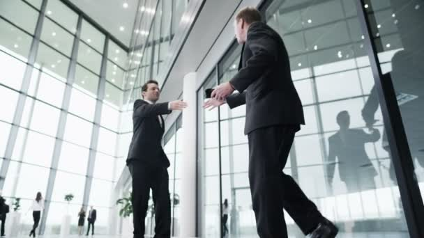 Business men in hurry meet and shake hands