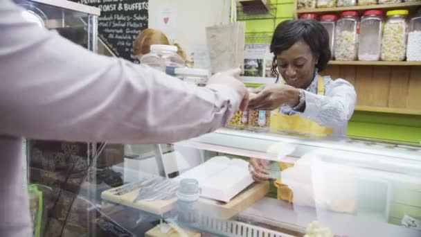 Happy female shopkeeper provides customer service with a smile