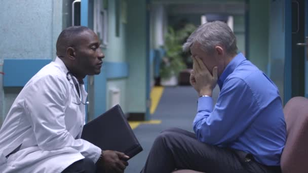 Man in hospital is given bad news by doctor