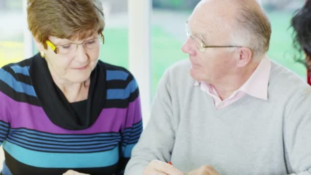 Senior couple sign up for an investment