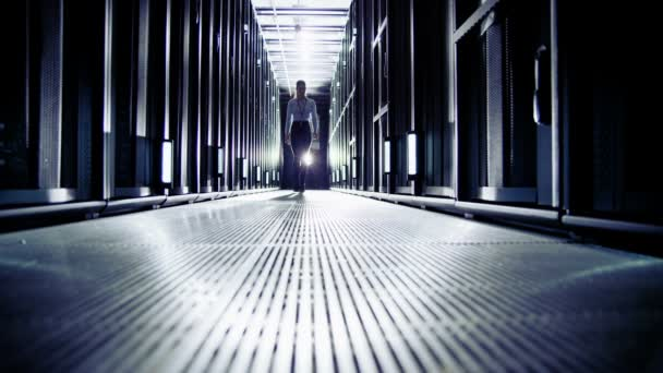 Female IT engineer is working in data center