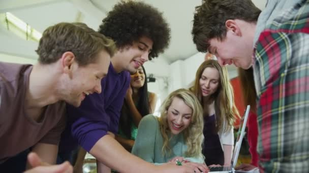 Diverse group of young students working together on a project