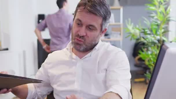Business people in a light and modern open plan office space