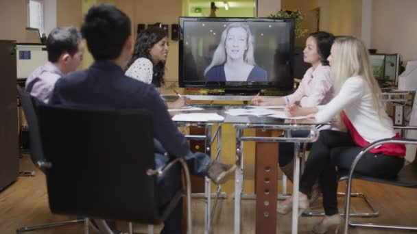 Young professional business team in a meeting via video call