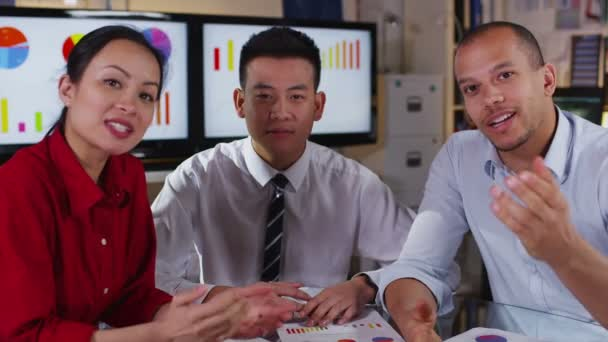 Attractive mixed ethnicity business team take a conference call