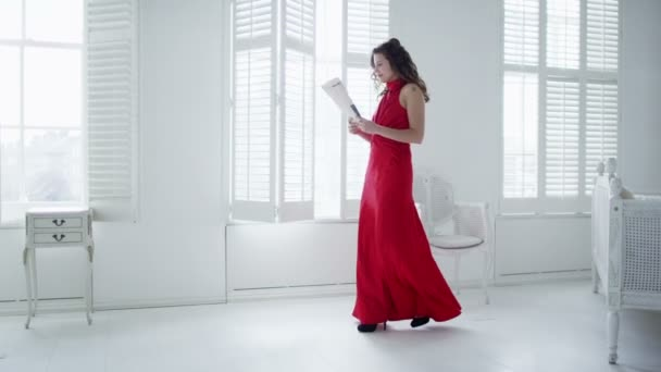 woman in red evening gown returns home