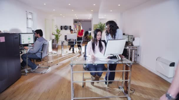 Business people working together in a light and modern open plan office space