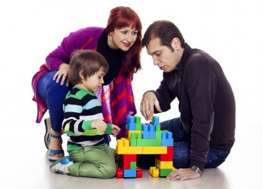 Family of three playing lego