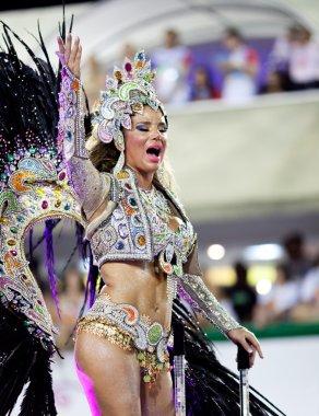RIO DE JANEIRO - FEBRUARY 11: A woman in costume dancing and sin