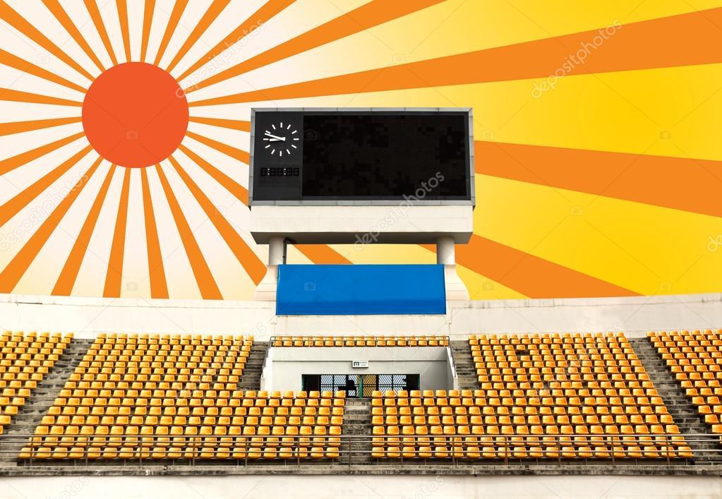 Stadium with scoreboard and sun ray