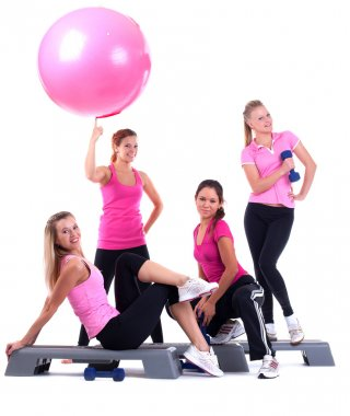 Group of fitness instructors stand with accesories