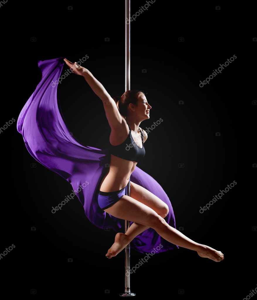 girl show gymnastic exercise with pole dance stock photo wisky