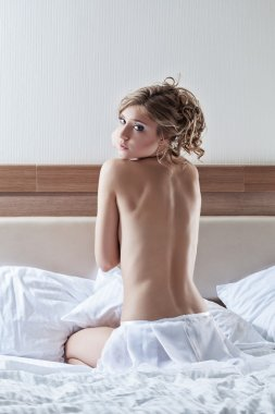 Pretty woman sitting on bed