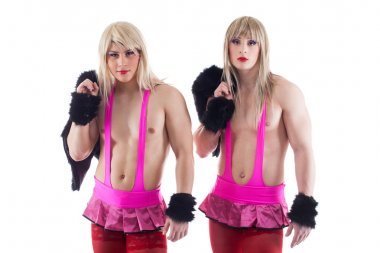 Two transvestites in pink costumes