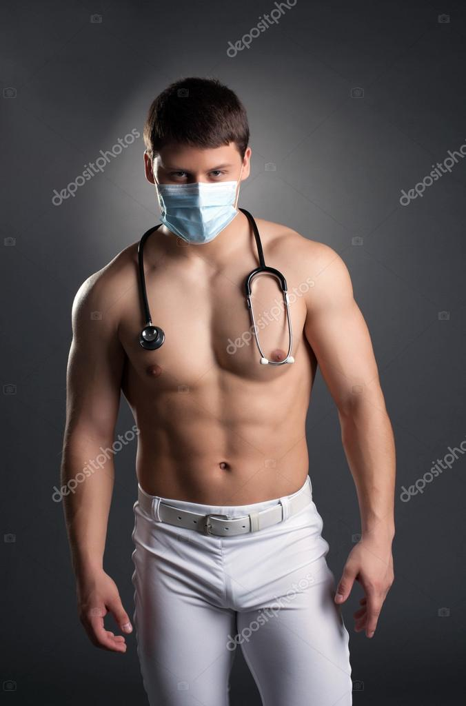 Sexy dancer in doctor costume with stethoscope