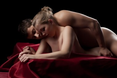 Couple having sex in silk sheet