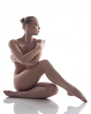 Image of pretty naked woman posing in studio