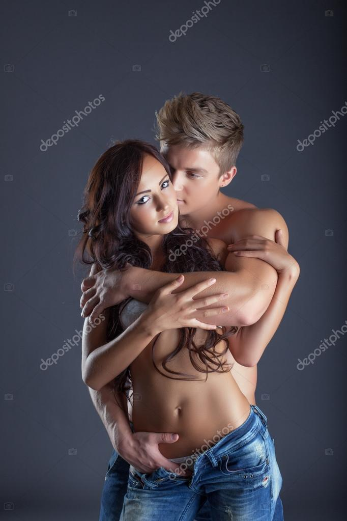 Portrait of passionate lovers posing in studio