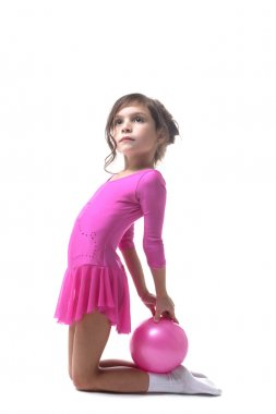 Image of cute little gymnast posing with ball