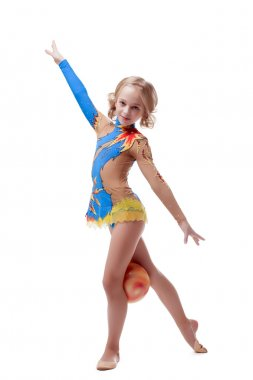 Little artistic gymnast posing looking at camera