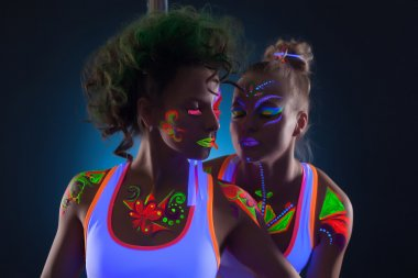 Image of sensual dancers with fluorescent makeup