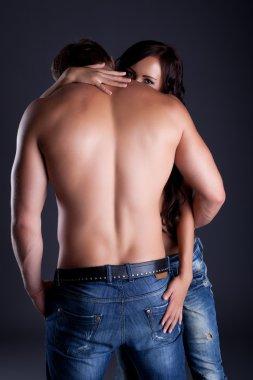 Shy girl looking over her lover's shoulder