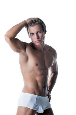 Shot of handsome muscular man advertises underwear