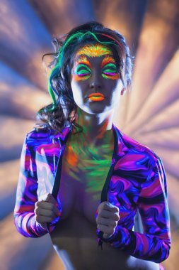 Portrait of attractive woman with UV disco make-up