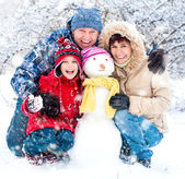 Fotografie Happy family with snowman