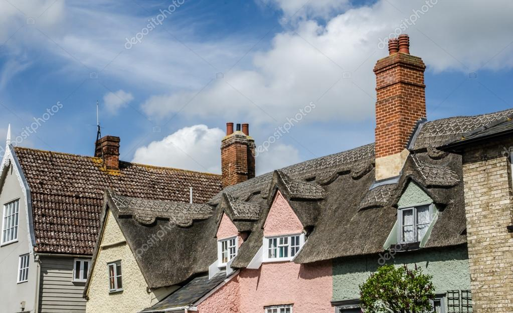 Roof tops with thatch and brick chimneys