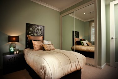 Bedroom interior reflected in mirrors