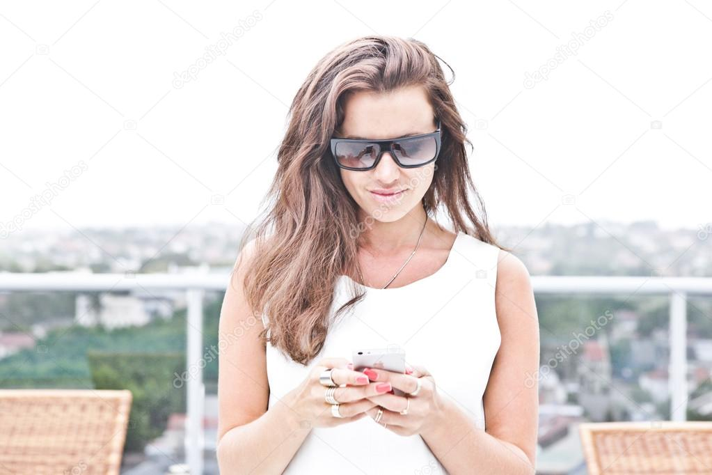 Attractive woman texting on her mobile