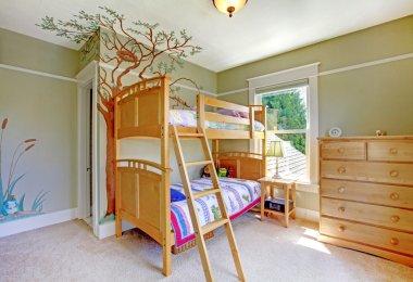 Baby girl bedroom with double bulk bed.