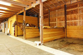 Fotografie Interior of shed with horse stables.
