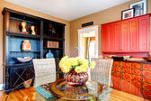 Charming dining room with glass dining table and wicker rustic c