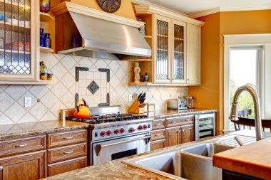 Wood kitchen room with decorated tile backsplash