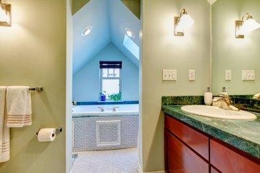 Green and blue bathroom with big whirpool