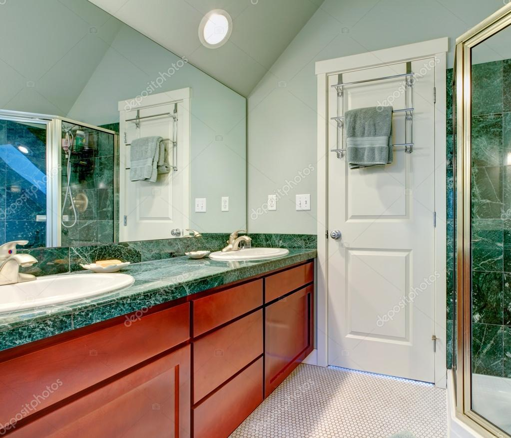 Refreshing Light Green Bathroom With Bright Brown Cabinets Stock