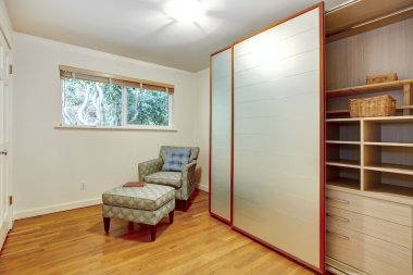 Bright small room with slide doors wardrobe cabinet