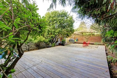View of the backyard from a wooden deck