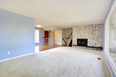 Empty beautiful living room with a rocky background fireplace