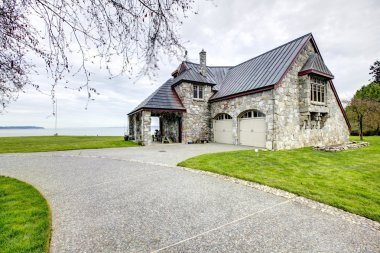 Amazing stone house with column porch and two car garage