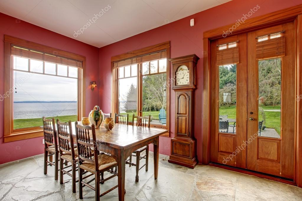 Burgundy dining room with antique grandfather clock — Stock Photo ...