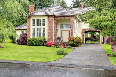 Luxury brick house with siding trim